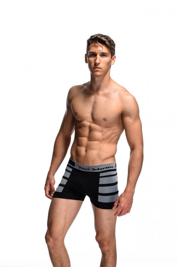 Model wearing purple seamless boxers with large black stripes on side